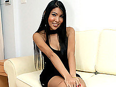 Beautiful Oriental transsexual Anne is all dressed up to go out in her little black dress.  This girl will let you take her out to wine her and dine her - and then she'll take you home to drill you in from Ladyboy Juice