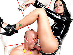 Viviany has a playmate this time and she has him strung up like a pig. She is..