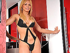 Beautiful tranny, Raica Ferrari is definitely rocking the party with her one-piece lingerie piece that just screams KINK! She massages her nice, bodacious bum, fuck, just look that black thong run up from Tranny Auditions