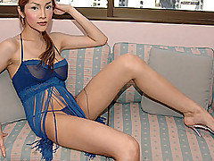 Redhead ladyboy MILF Pammy invites you to her high-rise apartment for an afternoon of quiet fun. She's already wearing blue lingerie with plenty of lace.  Her curves are tantalizingly underneath the f from Ladyboy Juice