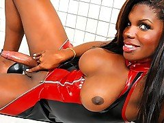 This gorgeous tgirl looks great stuffed into her red and black latex dress. Her round tits force their way up and out of that tight rubber and beg to be squeezed hard. She slowly teases her curvacious from TS Latex