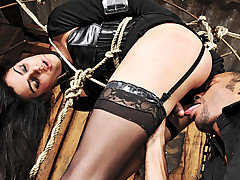 Poor Bianca wasn't quite prepared for the extensive punishment that this inked stud had in store for her.  He left her tied up and hanging for what she felt were hours upon hours. When he returned he from Tranny Edge