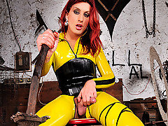Jump into a real live comic book as you watch Joy Spears in her tight yellow latex.  She jumps right in with her sword at the ready to save you from a day of sexual boredom. You will blow your mind as from TS Latex