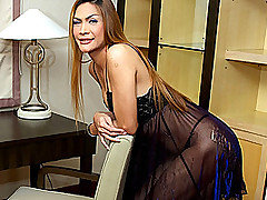 These sexy shemales just keep getting hotter and hotter!  In this fantastic ladyboy video, blond transsexual MILF Justine shows off her still hot body and large, quivering cock.  This babe is certainl from Ladyboy Juice