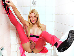 Laviny is one nasty shemale that just took over the public bathroom in her hot pink latex dress and skin tight leggings. She loved teasing her monster cock in the bathroom stall until it grew to its f from TS Latex