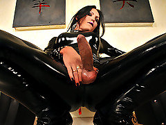 Ts Luciana Foxx is an extremely sexy shemale babe but I have never seen her look as sexy as she does in this update. Check her out in this tight black full bodied latex suit and high heels! If you lik from TS Latex