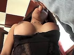 Hot ebony shemale throats huge cock from shemalehotties.com
