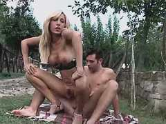 Tgirl sucks n jumps on cock outdoor from theshemaleporn.com