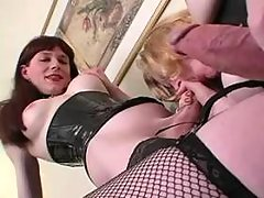 Two TS in sexy outfit in oral fun from thebestshemales.com