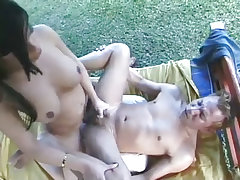 Busty brunette tranny bones a hard tight asshole from Cum Filled Trannys